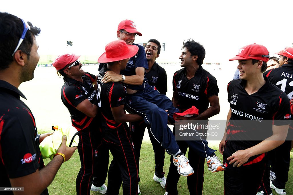 The victorious Hong Kong team hoist their coach following their victory in the Papua New Guinea v Hong Kong Quarter Final match 64 at the ICC World Twenty20 Qualifiers at the Zayed Cricket Stadium on November 28, 2013 in Abu Dhabi, United Arab Emirates.