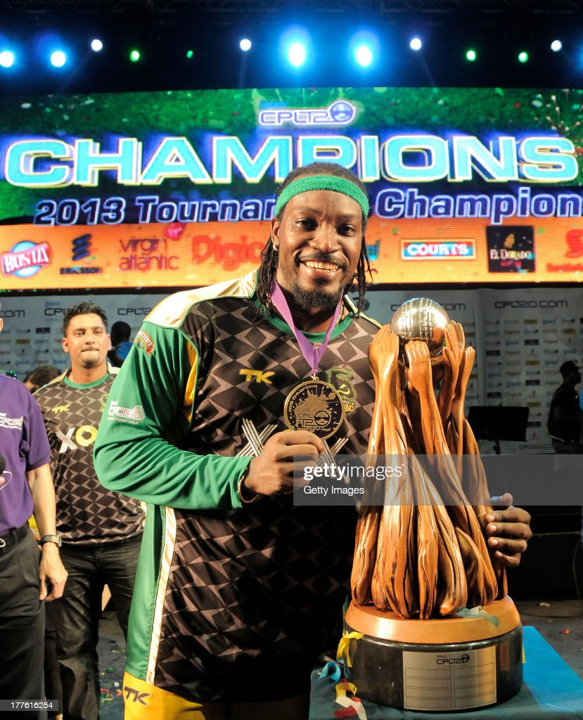 The victorious Jamaica Tallawahs Captain Chris Gayle poses with the Trophy after winning the Final of the Cricket Caribbean Premier League between Guyana Amazon Warriors v Jamaica Tallawahs at Queen's Park Oval on August 24, 2013 in Port of Spain, Trinidad and Tobago.