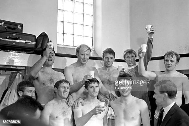 The victorious Manchester City players drinking a toast in champagne after beating Newcastle United by four goals to three at St Jame's Park...