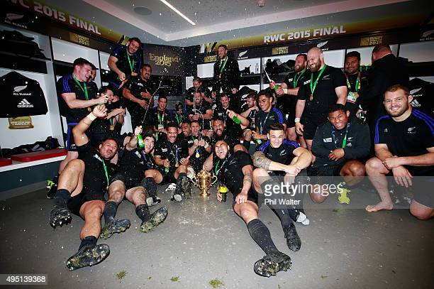 The victorious New Zealand players celebrate in the dressing room after the 2015 Rugby World Cup Final match between New Zealand and Australia at...
