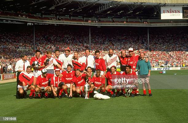 The victorious Nottingham Forest team pose for a photograph after the Littlewoods Cup Final against Oldham at Wembley Stadium in London Nottingham...