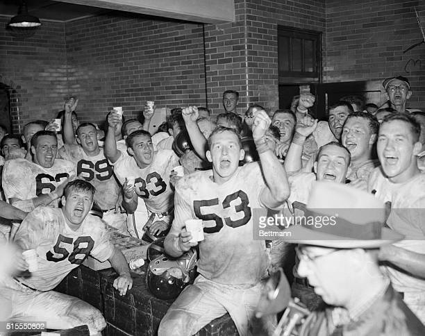 The victorious Purdue Boilermakers are shown celebrating in their dressing room after scoring the upset of the week by defeating Notre Dame 27 to 14...