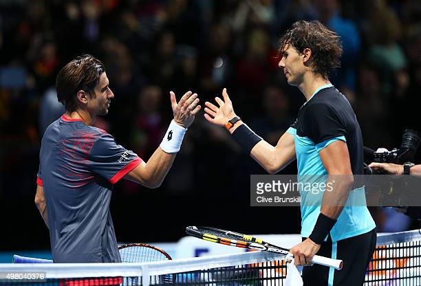 The victorious Rafael Nadal of Spain shakes hands with David Ferrer of Spain following his victory during their men's singles match on day six of the...