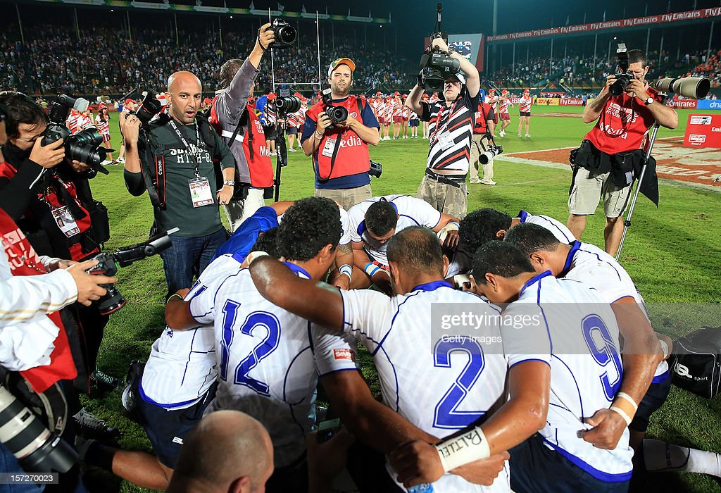 The Victorious Samoan team sing after their win over New Zealand in the final during the Emirates IRB Dubai Sevens, Round 2 of the HSBC Sevens World Series on December 1, 2012 in Dubai, United Arab Emirates.