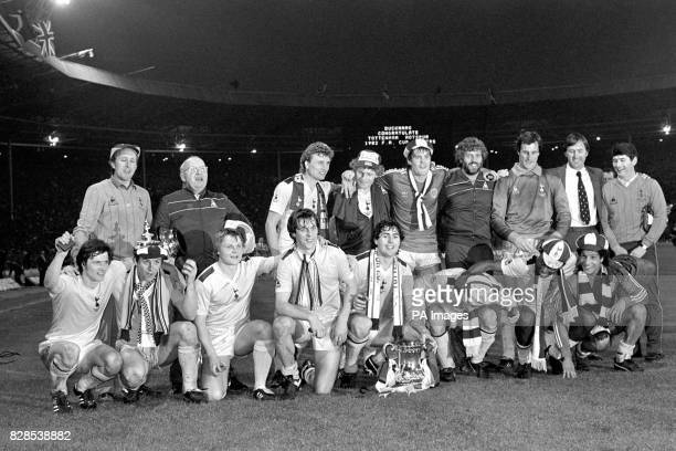 The victorious Tottenham Hotspur team at Wembley last night after beating Queen's Park Rangers 10 in the FA Cup Final replay with the trophy in front...