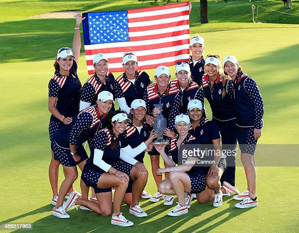 The victorious United States Team celebrate with the trophy after the closing ceremony during the final day singles matches in the 2015 Solheim Cup...