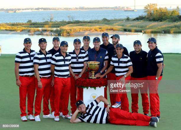 The victorious United States team pose with the Presidents Cup Brooks Koepka Kevin Chappell Daniel Berger Kevin Kisner Justin Thoams Jordan Spieth...