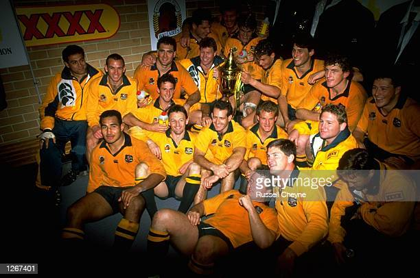 The victorious Wallabies celebrate their victory after winning the match against England in Sydney Australia Australia won the match 4015 Mandatory...
