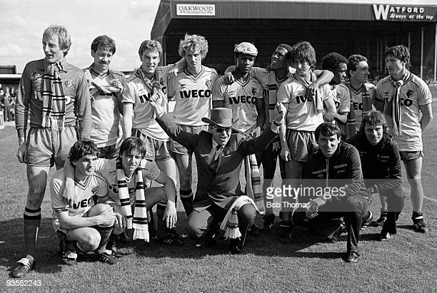 The victorious Watford team at the end of the season celebrate finishing second in Division 1 with chairman Elton John after beating Liverpool 21 at...
