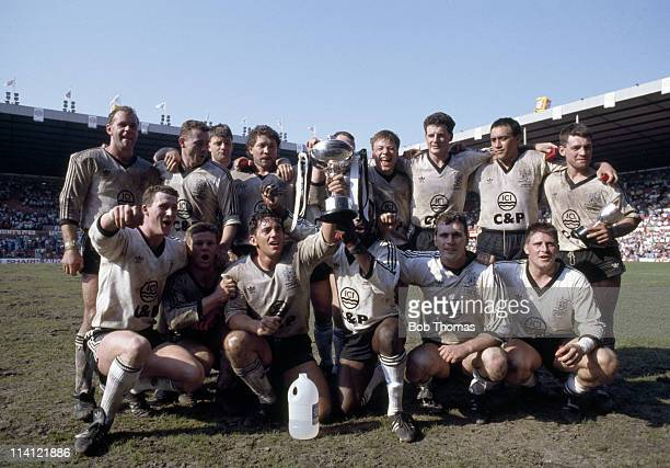 The victorious Widnes rugby league team with the trophy after defeating St Helens in the Rugby League Premiership Final at Old Trafford Manchester on...