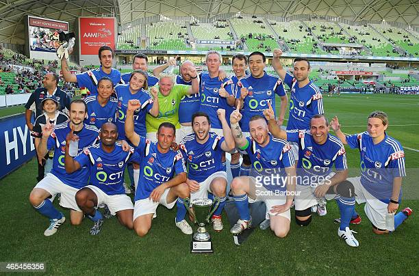 The Victory Fans team pose with the trophy after winning the Victory All stars v Victory Fans match before round 20 ALeague match between Melbourne...