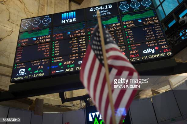 The video board is seen after the Dow Jones closing bell at the New York Stock Exchange February 21 2017 in New York US stocks jumped with retailers...