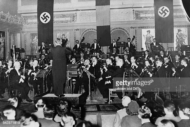 The Vienna Symphony Orchestra under conductor pianist and Nazi party member Hans Weisbach giving one of two concerts at the Romanian Athenaeum in...