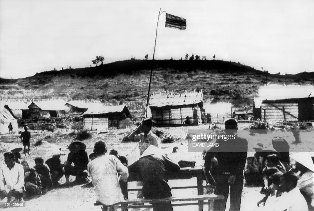 The Vietnamese flag flies over the village of Mai Lai 19 November 1969, where some 600 villagers were allegedly massacred by U.S Americal Division troops 16 March 1968. The U.S Army Criminal Investigation Division is probing the incident.