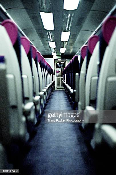 The view down the aisle of a railway carriage.