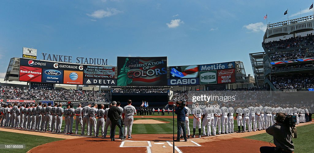 The view from behind home plate during pre-game ceremonies. The Boston Red Sox play the New York Yankees at Yankee Stadium during Opening Day of the 2013 MLB season.