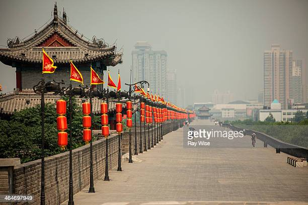 CONTENT] The view is on top of the Xian City Wall looking down the vanishing line of beautiful red paper lanterns A the points converge in the...