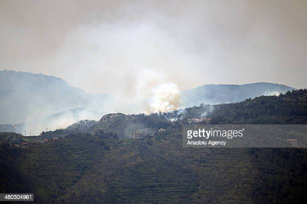 The view of clashes between Syrian opposition forces and regime forces in Latakia's Kasab town on March 24 in Hatay Turkey After the regime forces...