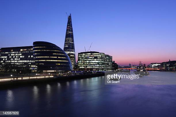 The view of the River Thames looking west from Tower Bridge including The Shard Skyscraper City Hall and HMS Belfast at night on March 28 2012 in...