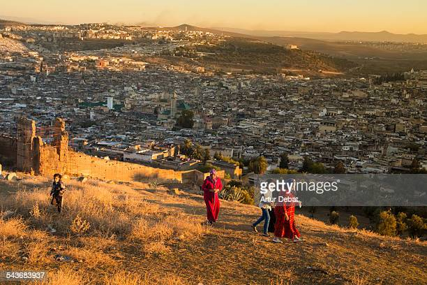 The views from the ruins on the hill of the Fez city on sunset with people Morocco Africa November 27th of 2013