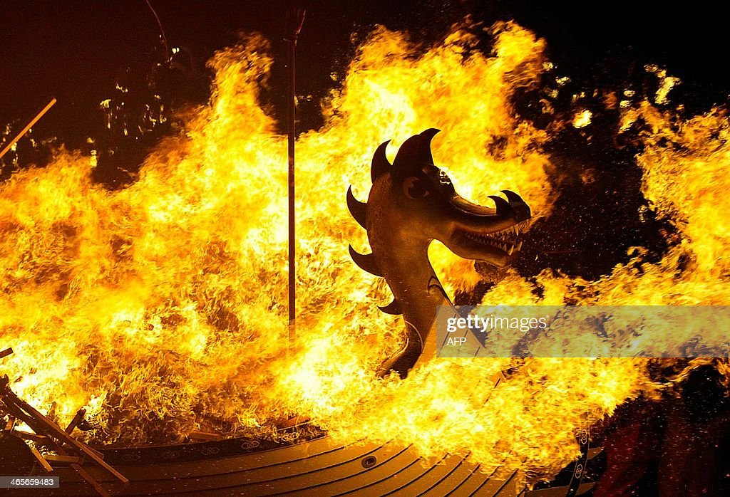 The Viking longboat burns during the annual Up Helly Aa festival in Lerwick Shetland Islands on January 28 2014 Up Helly Aa celebrates the influence...