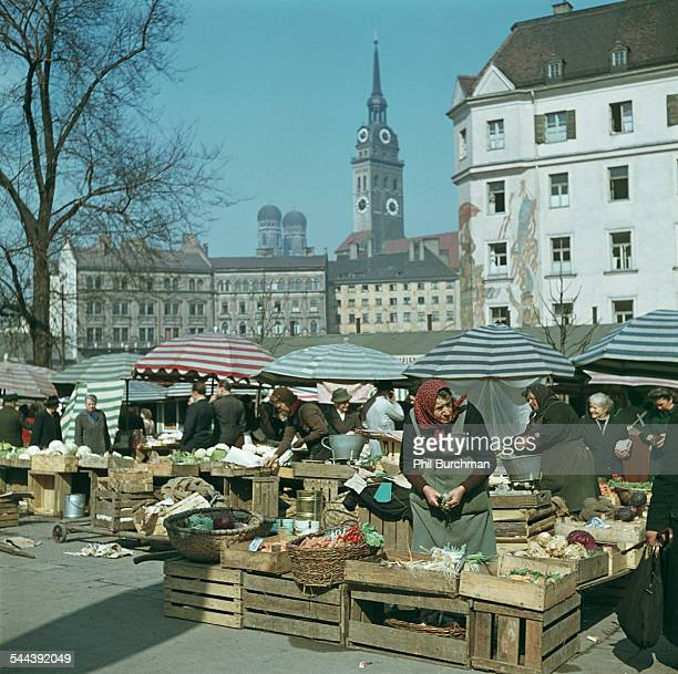 The Viktualienmarkt in Munich Germany with the twin domes of the Frauenkirche in the background circa 1965