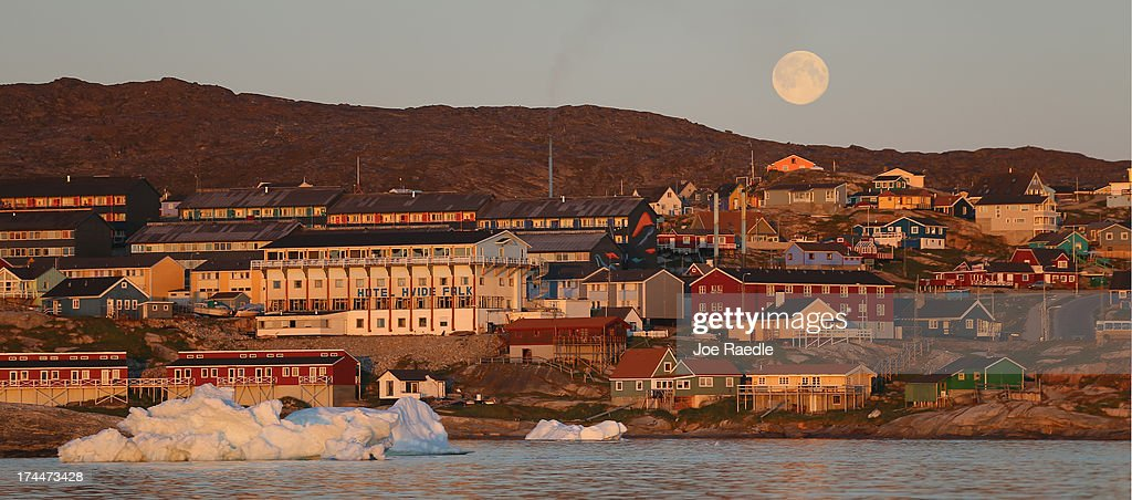 The village of Ilulissat is seen near the icebergs that broke off from the Jakobshavn Glacier on July 24, 2013 in Ilulissat, Greenland. As the sea levels around the globe rise, researchers affilitated with the National Science Foundation and other organizations are studying the phenomena of the melting glaciers and its long-term ramifications. The warmer temperatures that have had an effect on the glaciers in Greenland also have altered the ways in which the local populace farm, fish, hunt and even travel across land. In recent years, sea level rise in places such as Miami Beach has led to increased street flooding and prompted leaders such as New York City Mayor Michael Bloomberg to propose a $19.5 billion plan to boost the citys capacity to withstand future extreme weather events by, among other things, devising mechanisms to withstand flooding.
