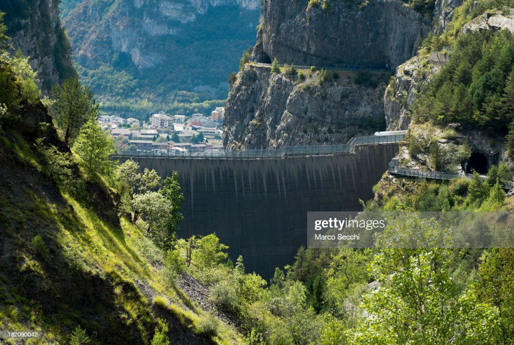 The village of Longarone is seen beyond the Vajont Dam on September 28, 2013 in Longarone, Italy. The Vajont Dam tragedy happened on the night of the October 9, 1963, when a landslide broke away from Monte Toc and fell into the Vajont River, causing a wave that struck the neighboring towns and killing more than 2000 people.