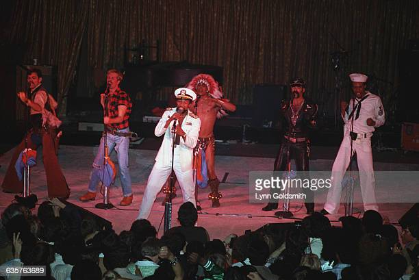 The Village People on stage performing All members are visible in this general view of the stage Photograph 1979