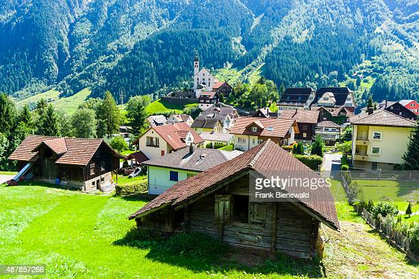 WASSEN GRAUBUENDEN SWITZERLAND The village with a church is located in a high altitude landscape with mountains green meadows and trees