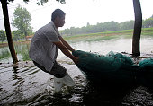 The villagers put away the nets in Niushan Lake on July 14 2016 in Wuhan Hubei Province China Armed police destroyed the 37kilometerlong embankment...