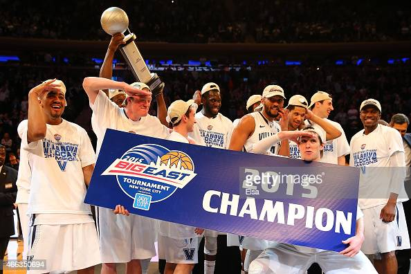 The Villanova Wildcats celebrate after defeating the Xavier Musketeers 6952 in the championship game of the Big East basketball tournament at Madison...