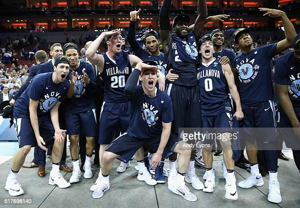 The Villanova Wildcats celebrate defeating the Kansas Jayhawks 6459 during the 2016 NCAA Men's Basketball Tournament South Regional at KFC YUM Center...