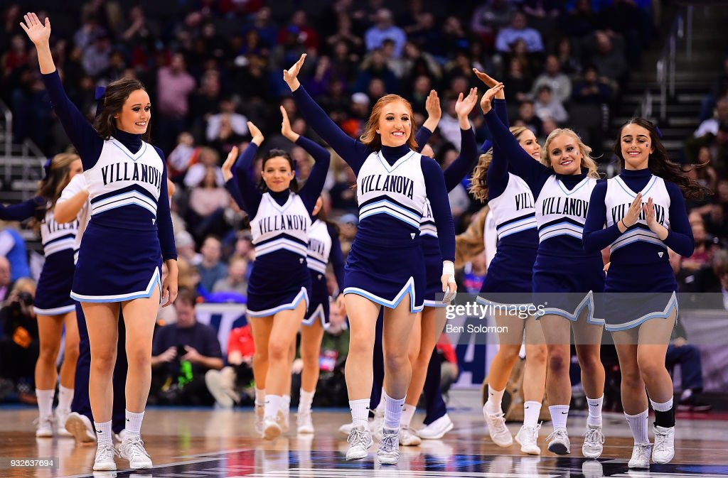 The Villanova Wildcats cheerleaders wave to the crowd during the game against the Radford Highlanders in the the first round of the 2018 NCAA Men's Basketball Tournament held at PPG Paints Arena on March 15, 2018 in Pittsburgh, Pennsylvania.