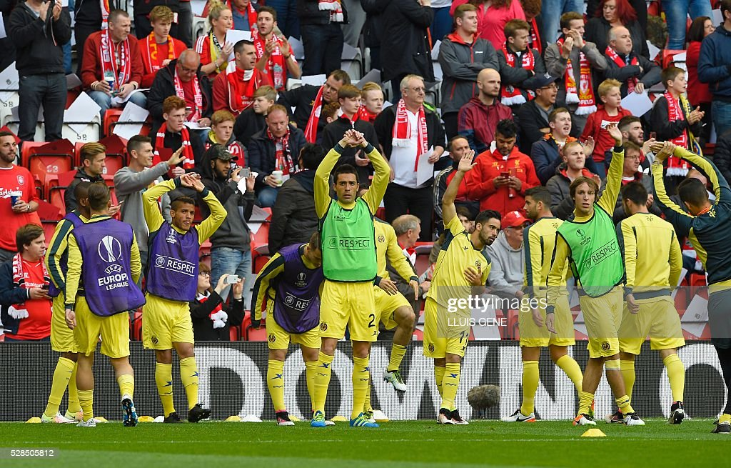 The Villarreal squad warm up before the start of the UEFA Europa League semi-final second leg football match between Liverpool and Villarreal CF at Anfield in Liverpool, northwest England on May 5, 2016. / AFP / LLUIS