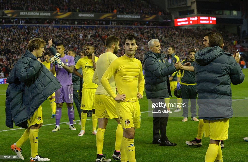 The Villarreal team are pictured at the final whistle after a 0-3 defeat during the UEFA Europa League semi-final second leg football match between Liverpool and Villarreal CF at Anfield in Liverpool, northwest England on May 5, 2016. / AFP / LLUIS