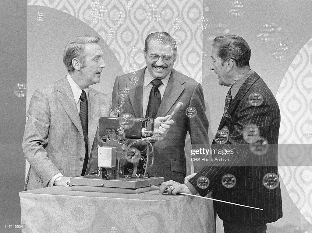 The <a gi-track='captionPersonalityLinkClicked' href=/galleries/search?phrase=Vin+Scully&family=editorial&specificpeople=878517 ng-click='$event.stopPropagation()'>Vin Scully</a> Show. From left, <a gi-track='captionPersonalityLinkClicked' href=/galleries/search?phrase=Vin+Scully&family=editorial&specificpeople=878517 ng-click='$event.stopPropagation()'>Vin Scully</a>, an unidentified bubble machine operator and <a gi-track='captionPersonalityLinkClicked' href=/galleries/search?phrase=Lawrence+Welk&family=editorial&specificpeople=714731 ng-click='$event.stopPropagation()'>Lawrence Welk</a> at right. Image dated April 11, 1972.