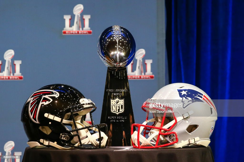 The Vince Lombardi Trophy and Atlanta Falcons helmet and New England Patriots helmet on display during NFL Commissioner Roger Goodell's press Conference on Feburary 01, 2017, at the George R Brown Convention Center in Houston, TX.