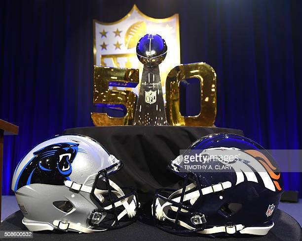 The Vince Lombardi Trophy sits on the table along with the helmets of the Carolina Panthers and the Denver Broncos before the start of the NFL Super...