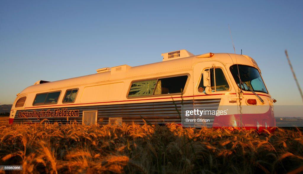 The vintage bus of the 'Outstanding In The Field,' farm dinner team sits on a road August 6, 2005 in Seattle, Washington. The team, under the leadership of artist/chef Jim Denevan, hosts organic farm dinners in esoteric locations across America and into Canada.