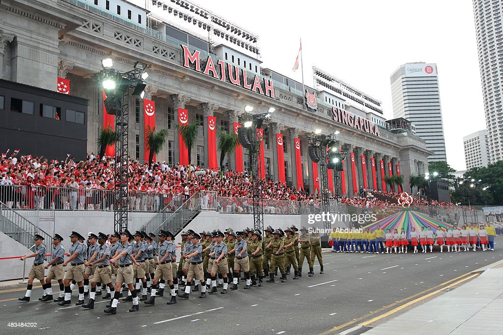 The vintage parade contingent march past in front of the City Hall during the National Day Parade at Padang on August 9, 2015 in Singapore. Singapore is celebrating her 50th year of independence on August 9, 2015.