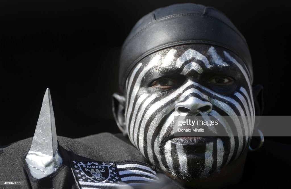 'The Violator', an Oakland Raiders fan, looks on from the stands during a game against the San Diego Chargers on December 22, 2013 at Qualcomm Stadium in San Diego, California.