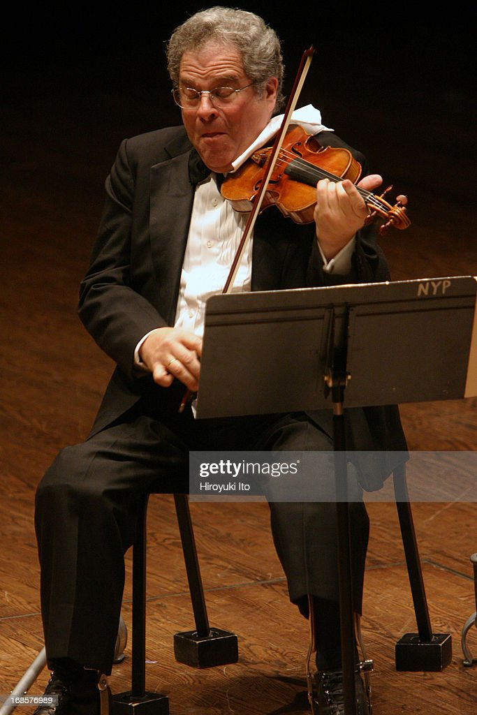 The violinist <a gi-track='captionPersonalityLinkClicked' href=/galleries/search?phrase=Itzhak+Perlman&family=editorial&specificpeople=593397 ng-click='$event.stopPropagation()'>Itzhak Perlman</a> performing at Avery Fisher Hall on Wednesday night, May 4, 2005. Rohan de Silva accompanies him on piano.This image:<a gi-track='captionPersonalityLinkClicked' href=/galleries/search?phrase=Itzhak+Perlman&family=editorial&specificpeople=593397 ng-click='$event.stopPropagation()'>Itzhak Perlman</a> (violin) performing Beethoven's 'Sonata for Violin and Piano No. 9.'