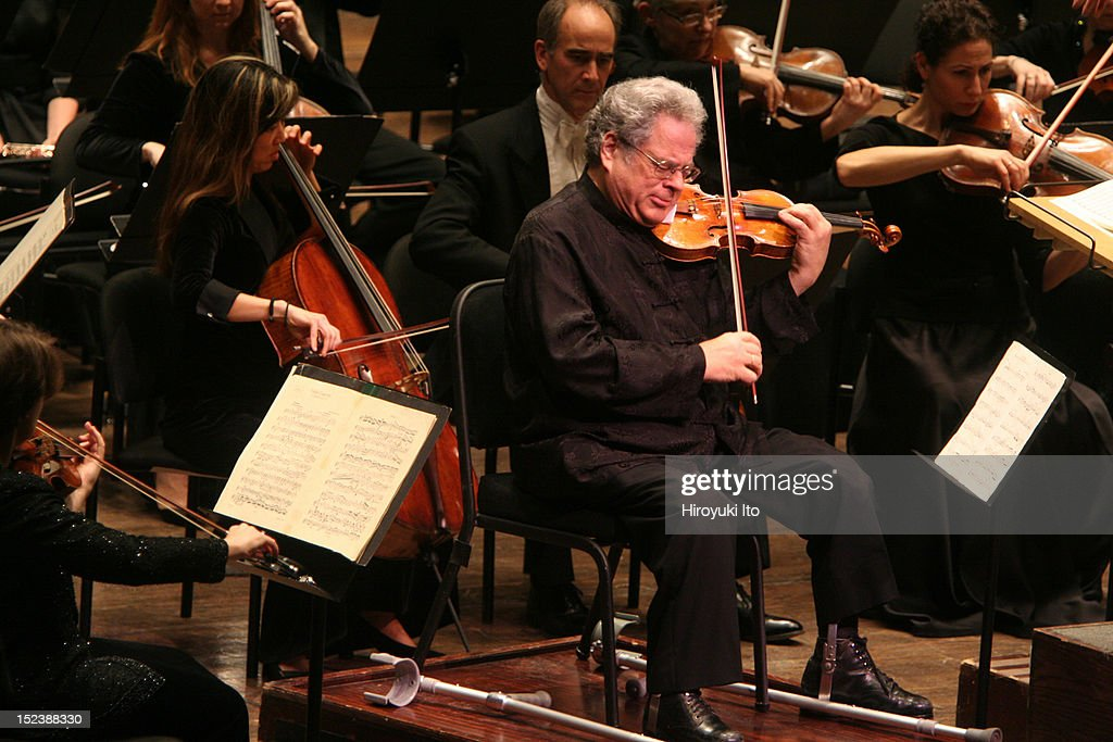 The violinist <a gi-track='captionPersonalityLinkClicked' href=/galleries/search?phrase=Itzhak+Perlman&family=editorial&specificpeople=593397 ng-click='$event.stopPropagation()'>Itzhak Perlman</a> performing with the New York Philharmonic, conducted by Daniel Boico, in 'A Concert to End Polio' at Avery Fisher Hall on Wednesday night, December 2, 2009.This image:<a gi-track='captionPersonalityLinkClicked' href=/galleries/search?phrase=Itzhak+Perlman&family=editorial&specificpeople=593397 ng-click='$event.stopPropagation()'>Itzhak Perlman</a> performing with the New York Philharmonic in Bruch's 'Violin Concerto No. 1 in G minor.'