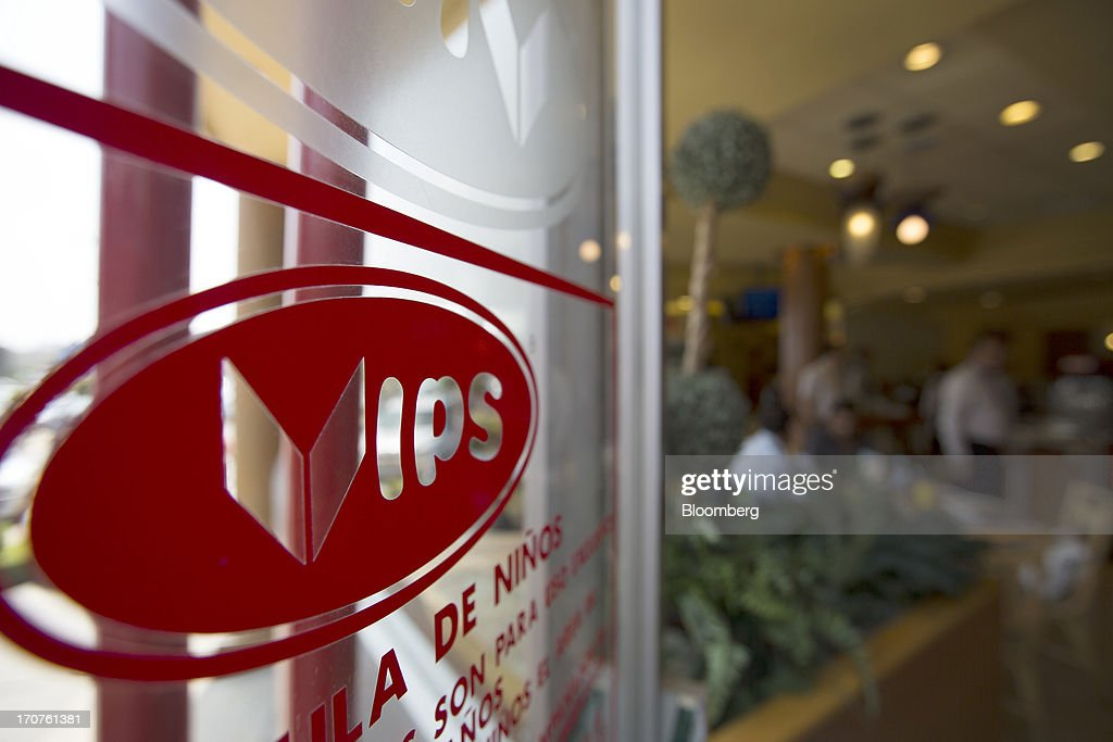 The Vips logo is displayed on the window of a restaurant in the El Toreo neighborhood of Mexico City, Mexico, on Monday, June 17, 2013. Wal-Mart de Mexico SAB de CV, known as Walmex, is considering offers to sell its restaurant division, which includes the Vips, El Porton, Ragazzi and La Finca brands. Photographer: Susana Gonzalez/Bloomberg via Getty Images
