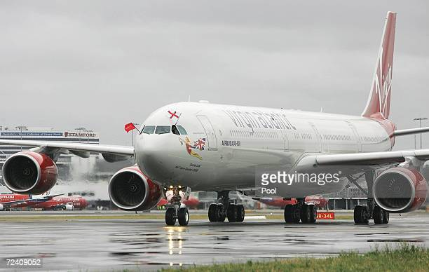 The Virgin Atlantic aircraft with the England Cricket team aboard flies the St George flag as they arrive at Sydney International Airport November 5...