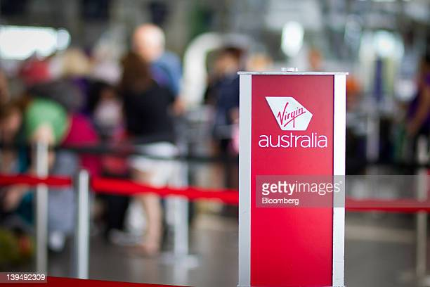 The Virgin Australia Holdings Ltd logo is displayed at the company's checkin area at the domestic terminal of Sydney airport in Sydney Australia on...