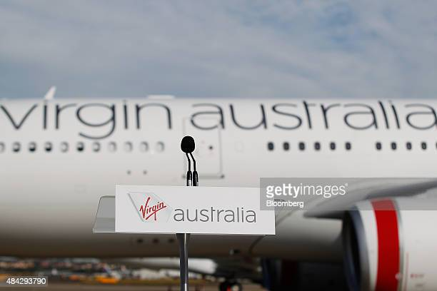 The Virgin Australia Holdings Ltd logo is displayed on a lectern in front of an Airbus SAS A330 aircraft at Sydney Airport in Sydney Australia on...