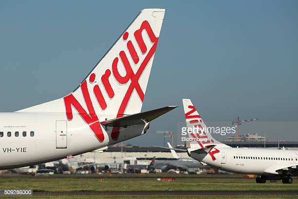 The Virgin Australia Holdings Ltd logo is displayed on the tails of a Boeing Co 737800 left and a Boeing Co 7378FE aircraft preparing to take off at...