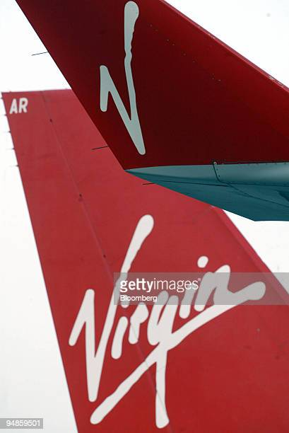The Virgin logo is seen on the winglet and tail of an Airbus A340400 as it is serviced at Logan International Airport in Boston Massachusetts March...